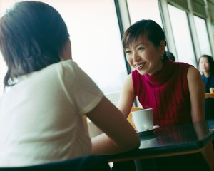 Asian Women Chatting over Coffee